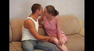 Young teenager couple on sofa